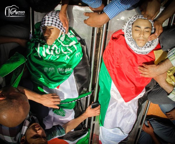 Bodies of two Palestinians killed on May 15, 2014, wrapped in Hamas and PLO flags