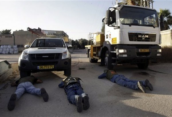 Workers of Israel Electric Company take cover from Hamas rockets