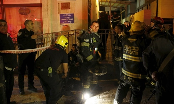Israeli firefighters extinguish fire at the Jerusalem offices of B'Tselem