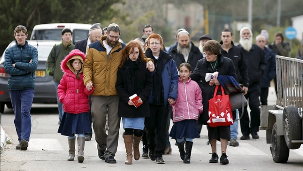 The family of Dafna Meir arrives for her funeral