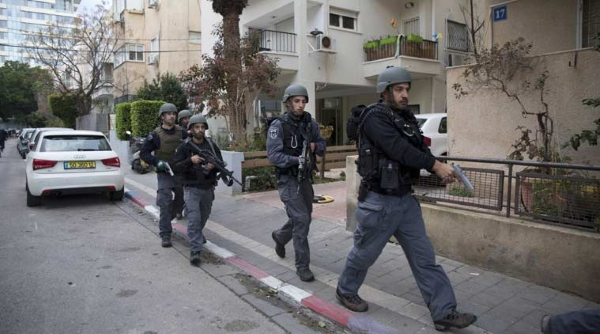Police comb North Tel Aviv for terrorist who killed at least two on Friday